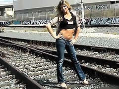 Angelina strips on the train tracks