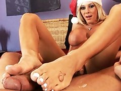 Sweet & horny Kimber James giving a xmas feetjob