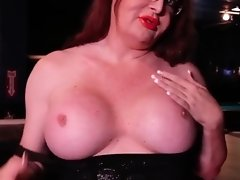 Wendy seduces tit worshippers by caressing and playing with her huge tits